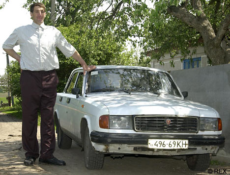 No, this isn't a toy, but at 8ft 5ins Leonid Stadnik makes this car look like a Mini